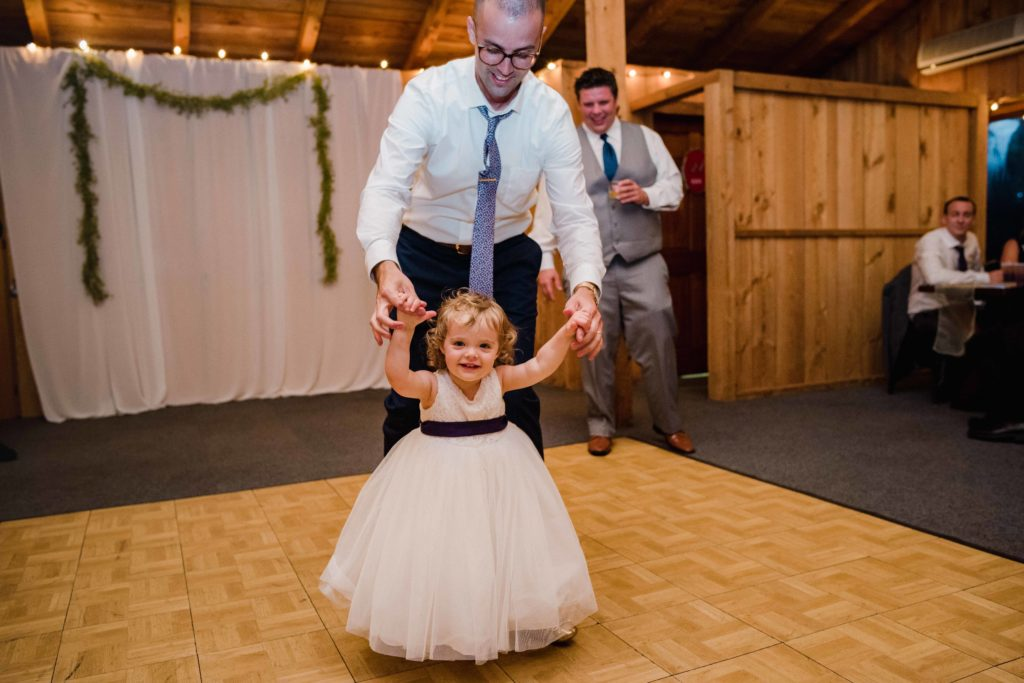 flower girl on reception dancefloor